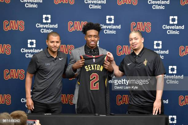 General manager Koby Altman and head coach Tyronn Lue of the Cleveland Cavaliers pose for a photo with Collin Sexton during a press conference on...