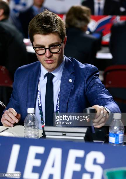 General manager Kyle Dubas of the Toronto Maple Leafs puts the phone down during the first round of the 2019 NHL Draft at Rogers Arena on June 21,...
