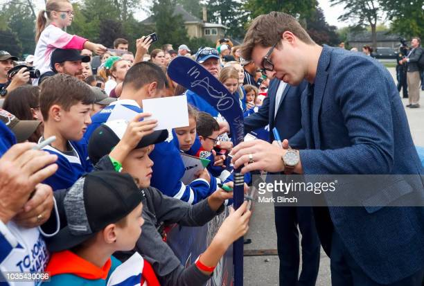 General manager Kyle Dubas of the Toronto Maple Leafs signs autographs for fans during Kraft Hockeyville Canada at the Lucan Community Memorial...