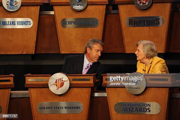 General Manager Larry Riley of the Golden State Warriors speaks to Irene Pollin owner of the Washington Wizards during the 2010 NBA Draft Lottery at...