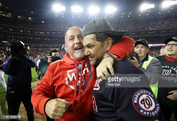 General manager Mike Rizzo and Manager Dave Martinez of the Washington Nationals celebrate after winning game four and the National League...
