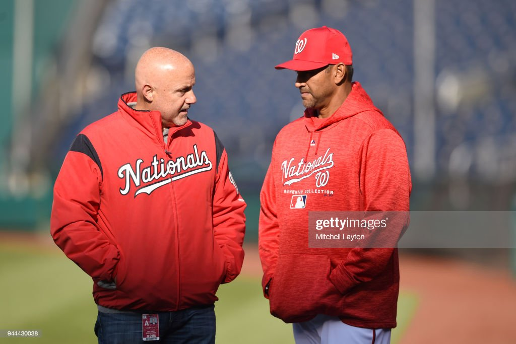 General manager Mike Rizzo and manager Dave Martinez #4 of the Washington Nationals talk during batting practice of a baseball game against the Atlanta Braves at Nationals Park on April 10, 2018 in Washington, DC.