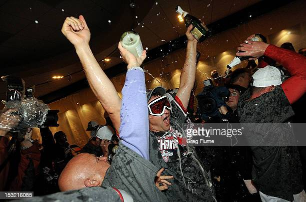 General manager Mike Rizzo and Ryan Zimmerman of the Washington Nationals celebrate after winning the National League East Division Championship...