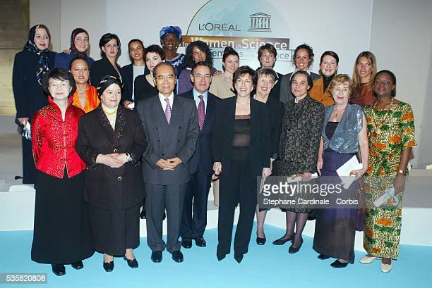 UNESCO general manager Mr Koichiro Matsuura L'Oreal CEO Mr Lindsay OwenJones with the 2003 laureates at the Awards ceremony with French journalist...
