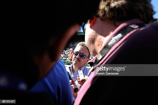 General manager Ned Colletti of the Los Angeles Dodgers speaks to reporters before the spring training baseball game against the San Francisco Giants...