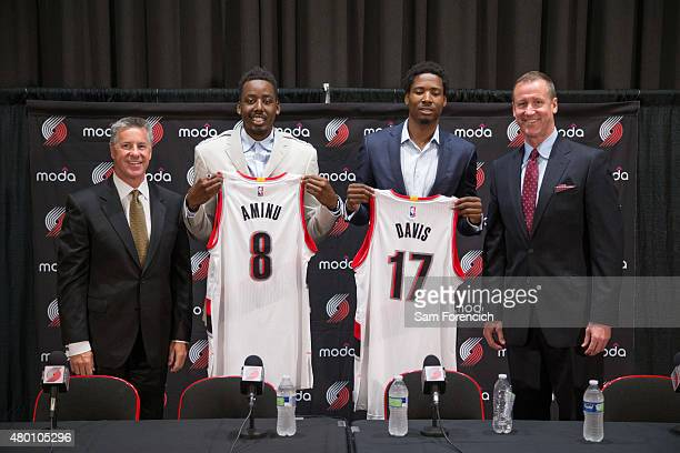 General Manager Neil Olshey and Head Coach Terry Stotts of the Portland Trail Blazers welcome new players AlFarouq Aminu and Ed Davis during a press...