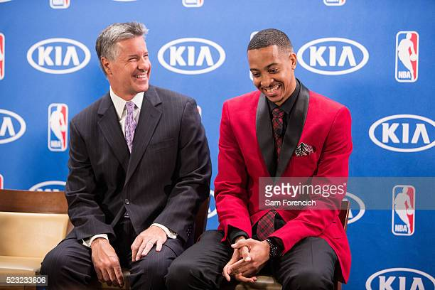 General Manager Neil Olshey joins CJ McCollum of the Portland Trail Blazers as he receives the 201516 Kia NBA Most Improved Players of the Year Award...