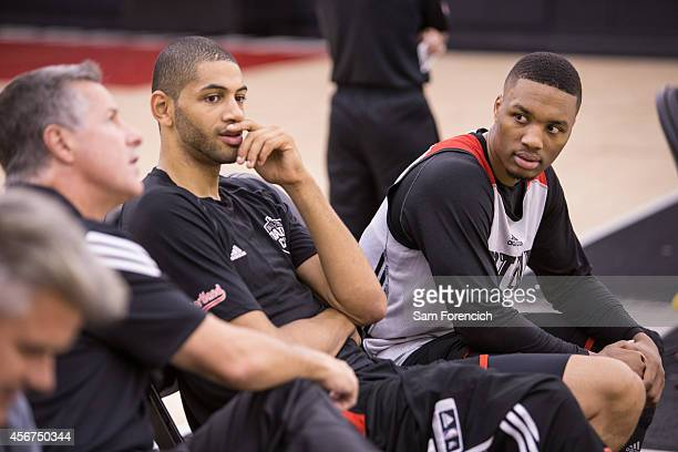 General Manager Neil Olshey Nicolas Batum and Damian Lillard of the Portland Trail Blazers watch during the team's practice October 3 2014 at the...