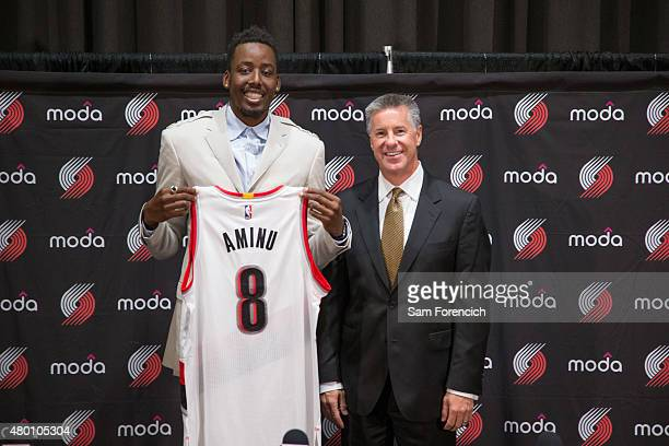 General Manager Neil Olshey of the Portland Trail Blazers welcomes new player AlFarouq Aminu during a press conference July 9 2015 at the Trail...
