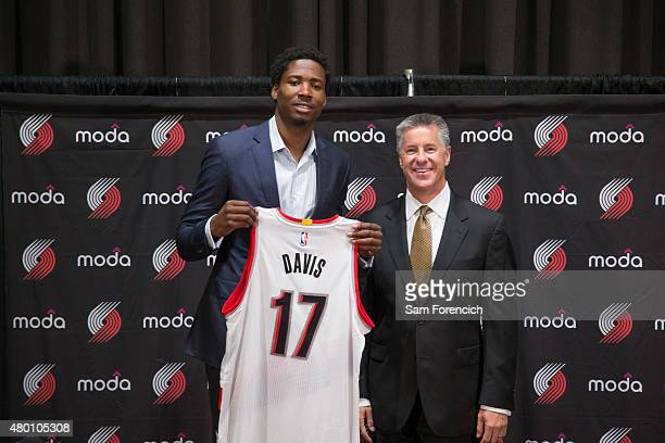 General Manager Neil Olshey of the Portland Trail Blazers welcomes new player Ed Davis during a press conference July 9 2015 at the Trail Blazer...
