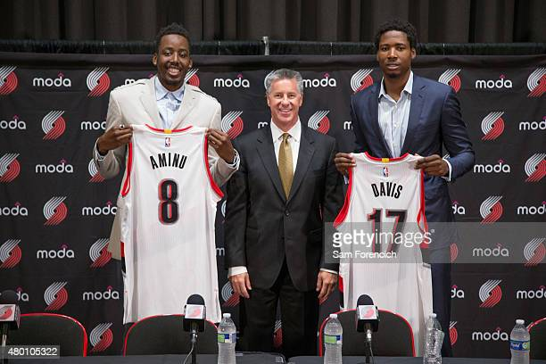 General Manager Neil Olshey of the Portland Trail Blazers welcomes new players AlFarouq Aminu and Ed Davis during a press conference July 9 2015 at...