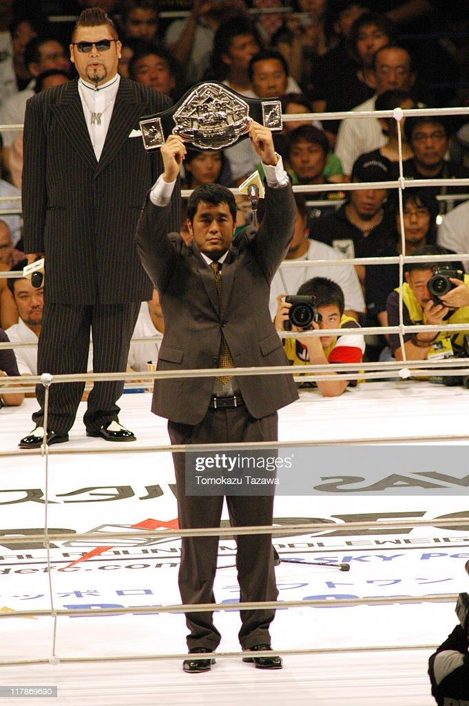 General Manager Nobuhiko Takada holding the Champion Belt