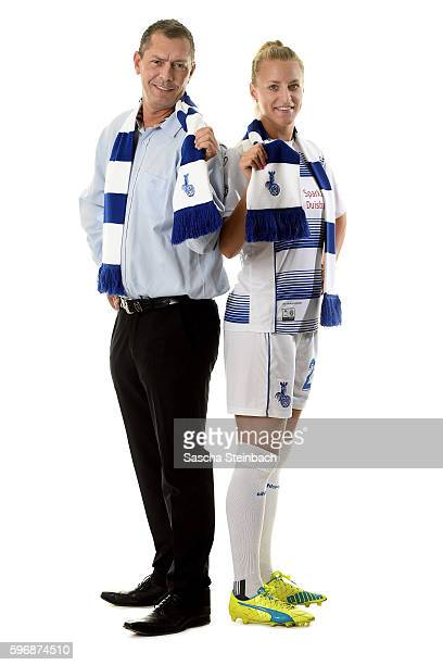 General manager of Allianz insurance Michael Schlagregen and Viginia Kirchberger of MSV Duisburg pose during the Allianz Women's Bundesliga Club Tour...