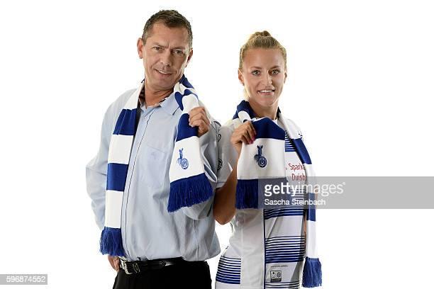 General manager of Allianz insurance Michael Schlagregen and Viginia Kirchberger of MSV Duisburg pose during the Allianz Women's Bundesliga Club Tour...