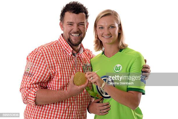 General manager of Allianz insurance Rene Marquardt and Alexandra Popp of VfL Wolfsburg pose during the Allianz Women's Bundesliga Club Tour on...