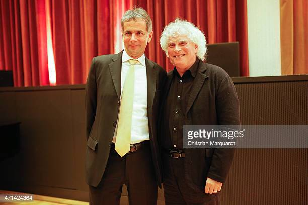 General Manager of Berliner Philharmoniker Martin Hoffmann and Chief Conductor and Artistic Director of Philharmonie Berlin Sir Simon Rattle attend a...