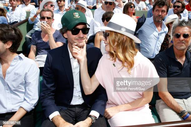 General manager of Berluti Antoine Arnault and Natalia Vodianova attend the 2018 French Open Day Thirteen at Roland Garros on June 8 2018 in Paris...
