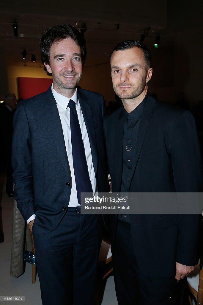 General manager of Berluti Antoine Arnault and Stylist Kris Van Assche attend the 'Icones de l'Art Moderne, La Collection Chtchoukine' : Cocktail at Fondation Louis Vuitton on October 20, 2016 in Paris, France.