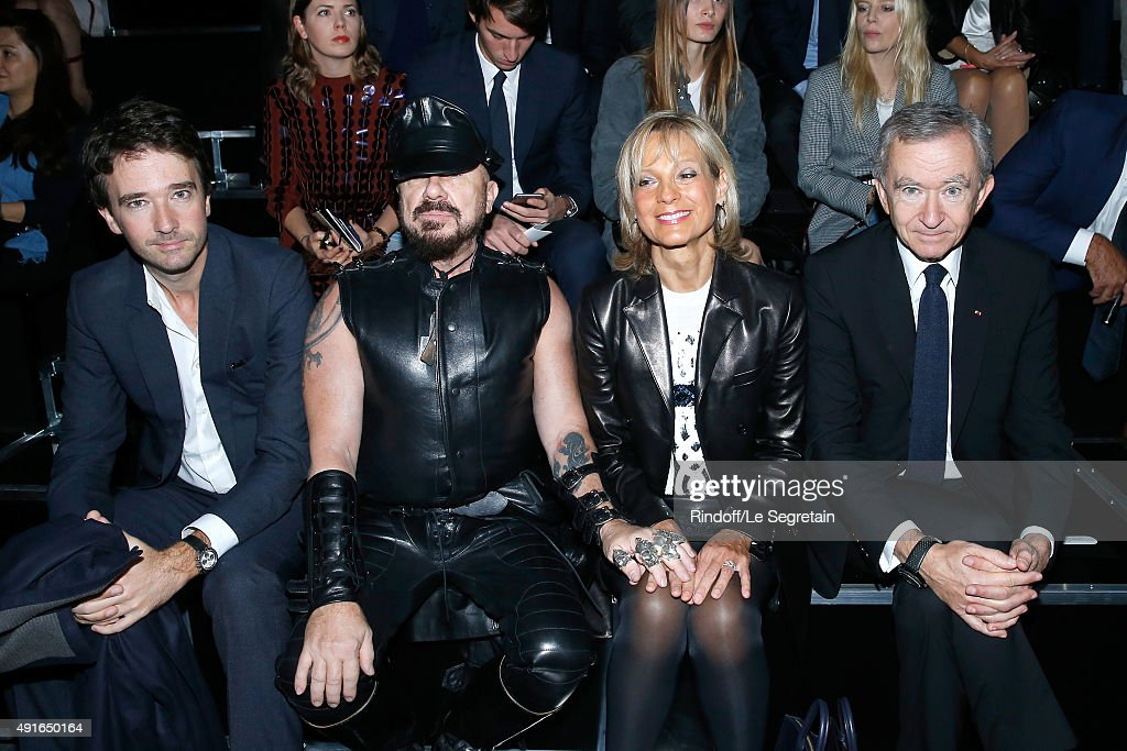 General manager of Berluti Antoine Arnault, Peter Marino and Owner of LVMH Luxury Group Bernard Arnault with his wife Helene Arnault attend the Louis Vuitton show as part of the Paris Fashion Week Womenswear Spring/Summer 2016. Held at Louis Vuitton Foundation on October 7, 2015 in Paris, France.