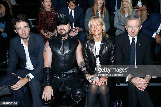 General manager of Berluti Antoine Arnault Peter Marino and Owner of LVMH Luxury Group Bernard Arnault with his wife Helene Arnault attend the Louis...