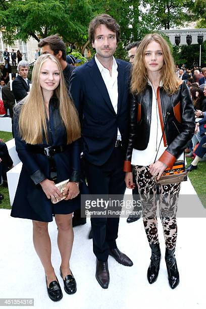 General manager of Berluti Antoine Arnault standing between Natalia Vodianova and her sister Kristina Kusakina attend the Berluti show as part of the...