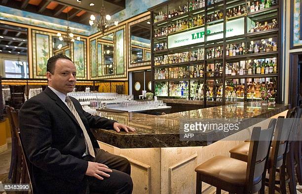 General manager of French Brasserie Lipp Mario Hernandez poses at the restaurant's bar in Mexico City on October 29 2008 Foie gras and boeuf...