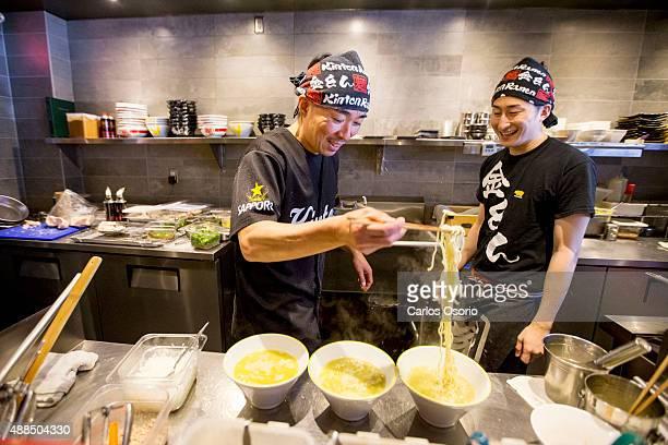 TORONTO ON JUNE 29 General Manager of Kinton Ramen at 668 Bloor Street West Aki Urata and cook Ryohei Ishida prepare 3 bowls of Chicken Spicy...