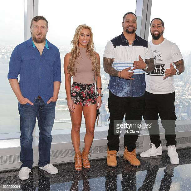 General manager of SmackDown Daniel Bryan WWE superstars Carmella Jimmy Uso and Hall of Famer Jey Uso pose for photographs during their visit to One...