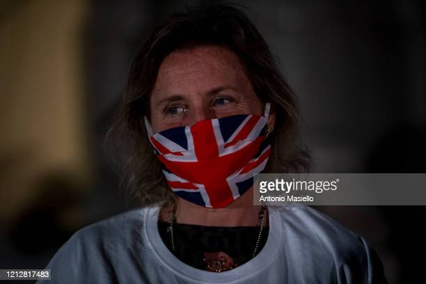 General Manager of Spallanzani hospital Marta Branca wearing a protective mask with the English flag takes part a happening to say thank you nurses...