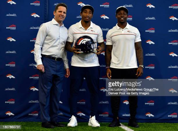 General Manager of the Denver Broncos George Paton , Denver Broncos cornerback Ronald Darby , and Broncos running back Mike Boone pose for a photo...