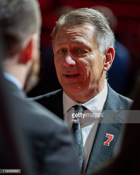 General Manager of the Detroit Red Wings Ken Holland talks to the Lindsay family during the public visitation of NHL Hall of Famer and former Detroit...