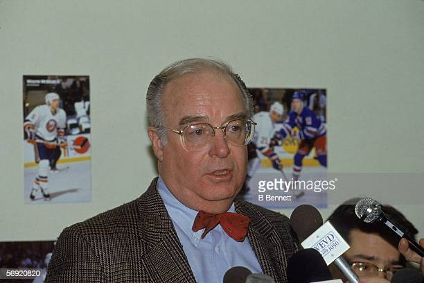 General Manager of the New York Islanders Bill Torrey answers questions from the press February 1991
