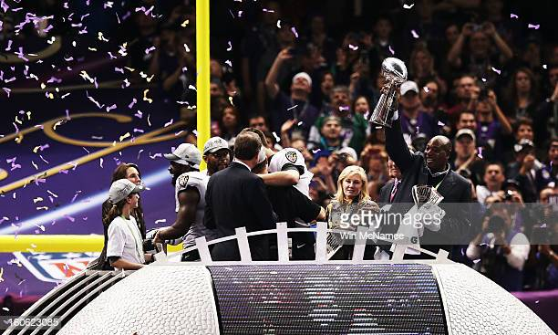 General manager Ozzie Newsome of the Baltimore Ravens celebrates with the VInce Lombardi trophy after the Ravens won 3431 against the San Francisco...
