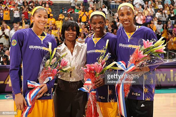 General Manager Penny Tolar Candace Parker Delisha MiltonJones and Lisa Leslie of the Los Angeles Sparks pose for a photo at halftime to celebrate...