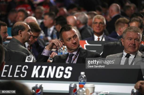 General manager Rob Blake left and assistant general manager Mike Futa of the Los Angeles Kings look on from the draft table during Round One of the...