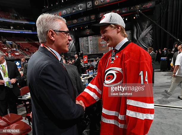 General Manager Ron Francis congratulates Josh Wesley after he was selected 96th overall by the Carolina Hurricanes during the 2014 NHL Entry Draft...