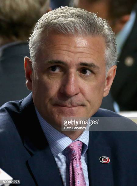 General manager Ron Francis of the Carolina Hurricanes looks on from the draft table during the 2017 NHL Draft at United Center on June 24, 2017 in...