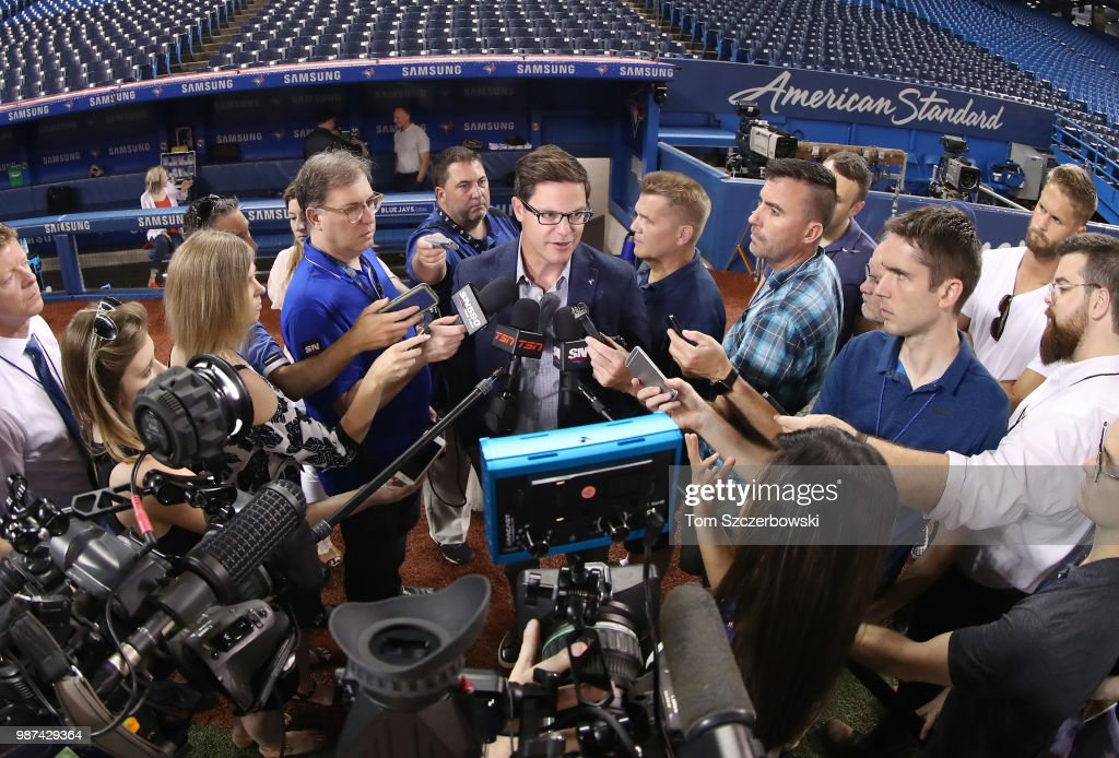 General manager Ross Atkins of the Toronto Blue Jays speaks to members of the media before the start of MLB game action against the Detroit Tigers at Rogers Centre on June 29, 2018 in Toronto, Canada.