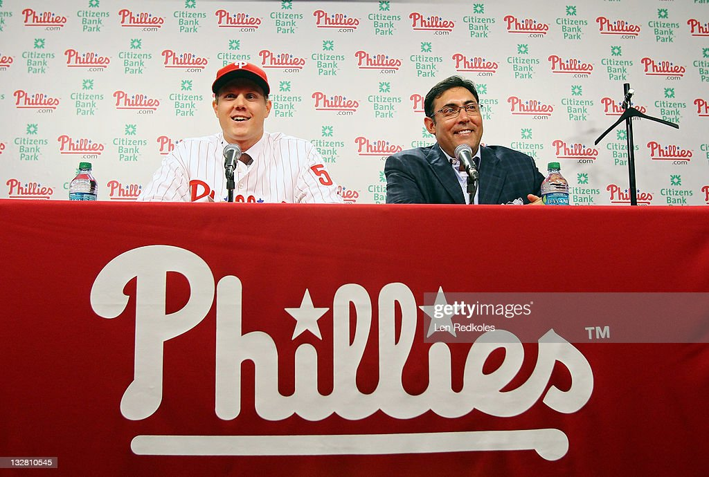 General manager Rubin Amaro Jr. (R) and Jonathan Papelbon of the Philadelphia Phillies discuss Papelbon's four-year, $50,000,058 contract, at Citizens Bank Park on November 14, 2011 in Philadelphia, Pennsylvania.