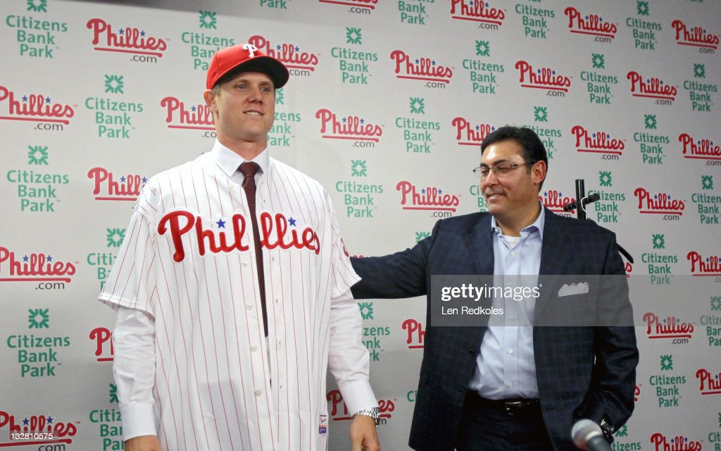 General Manager Rubin Amaro Jr. helps Jonathan Papelbon of the Philadelphia Phillies put on his new uniform as Papelbon signed a four-year, $50,000,058 contract, at Citizens Bank Park on November 14, 2011 in Philadelphia, Pennsylvania.