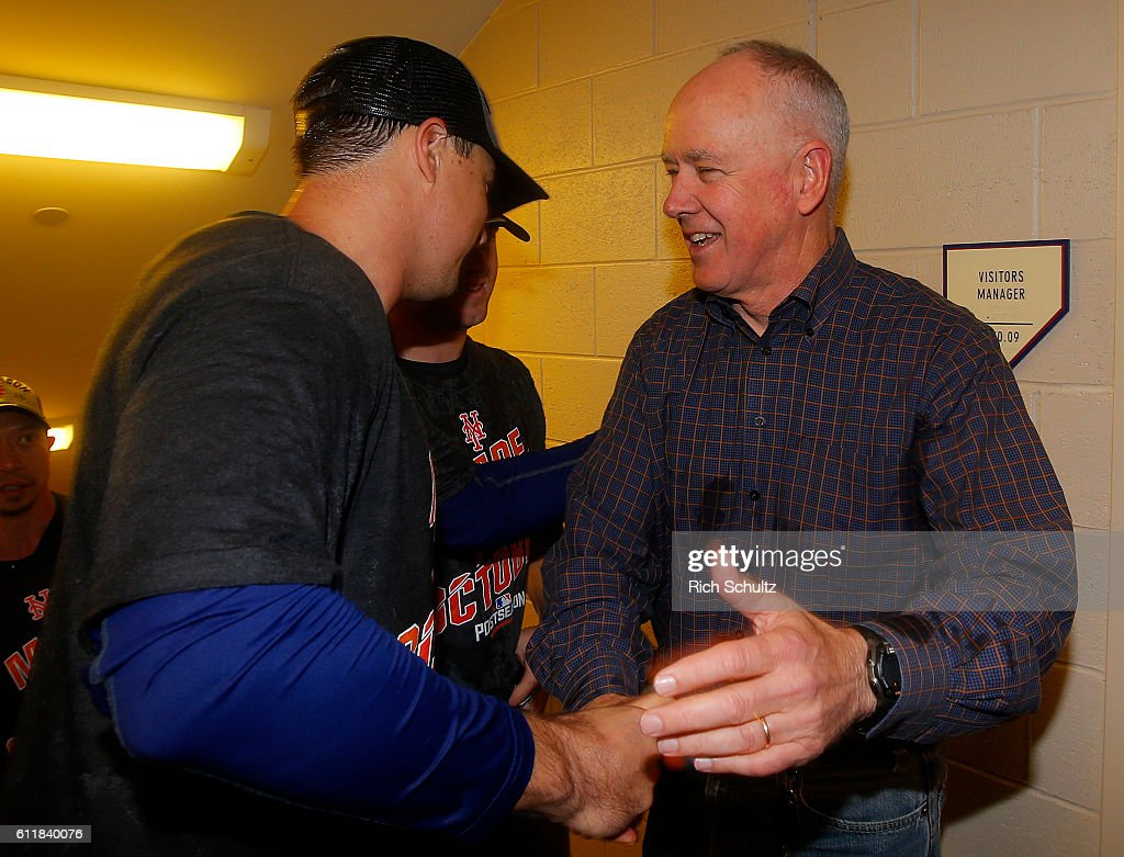 General Manager Sandy Alderson of the New York Mets greets players after the Mets defeated the Philadelphia Phillies 5-3 during a game at Citizens Bank Park on October 1, 2016 in Philadelphia, Pennsylvania. The win clinched a Wild Card game for the Mets.