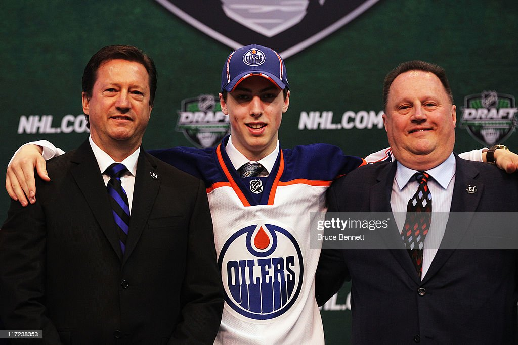 General Manager Steve Tambellini of the Edmonton Oilers, first overall pick Ryan Nugent-Hopkins of the Edmonton Oilers and a member of the Edmonton Oilers organization stand on the podium for a photo during day one of the 2011 NHL Entry Draft at Xcel Energy Center on June 24, 2011 in St Paul, Minnesota.
