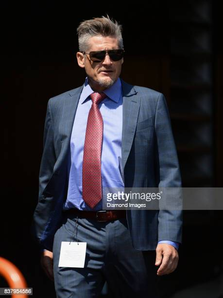 General manager Thomas Dimitroff of the Atlanta Falcons walks onto the field prior to a preseason game on August 20 2017 against the Pittsburgh...