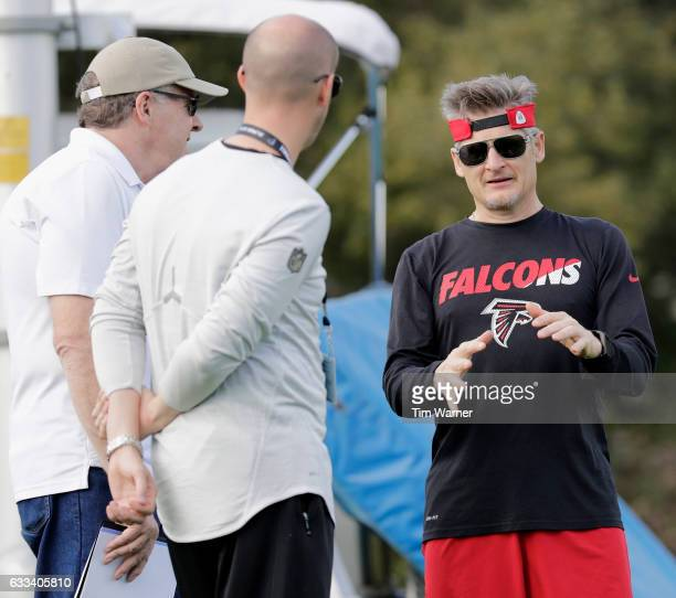 General Manager Thomas Dimitroff speaks with staff during a Super Bowl LI practice on February 1 2017 in Houston Texas