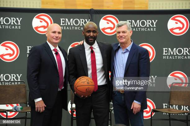 General Manager Travis Schlenk Head Coach Lloyd Pierce and owner Antony Ressler of the Atlanta Hawks pose for a photo on May 14 2018 at the Emory...