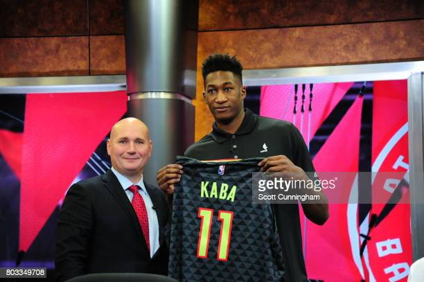 General Manager Travis Schlenk of the Atlanta Hawks introduces new draft pick Alpha Kaba during a Press Conference on June 26 2017 at Fox Studios in...