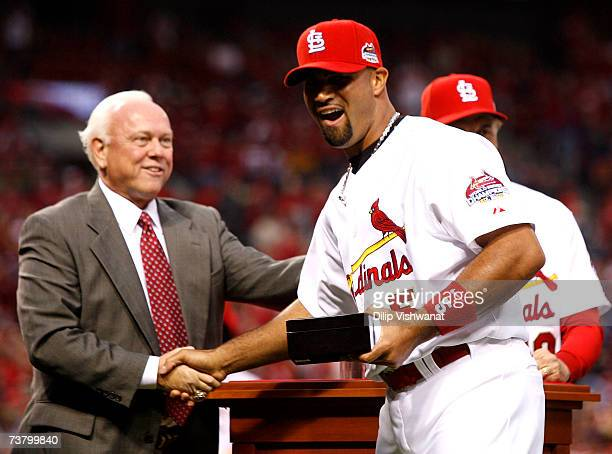 General Manager Walt Jocketty presents Albert Pujols of the St Louis Cardinals with his 2006 World Series Championship ring before playing the New...