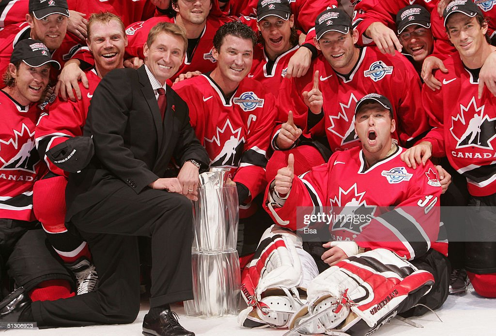 General manager Wayne Gretzky (suit) poses Mario Lemieux (R of Gretzky) and other members of Team Canada and the World Cup of Hockey trophy after they defeated Team Finland in the 2004 World Cup of Hockey Championship game on September 14, 2004 at the Air Canda Centre in Toronto, Ontario. Canada defeated Finland 3-2.
