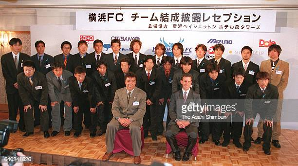 General manager Yasuhiko Okudera head coach Pierre Littbarski and players of newly founded Yokohama FC pose for photographs at a team founding...