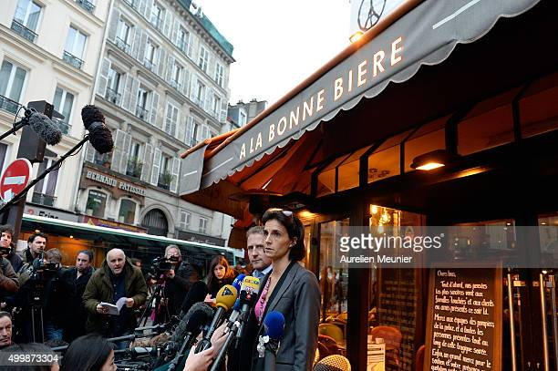 General Managers Romain Debray and Audrey Bily speak to the press at the 'La Bonne Biere' reopening after the Paris terrorist attacks on December 4...